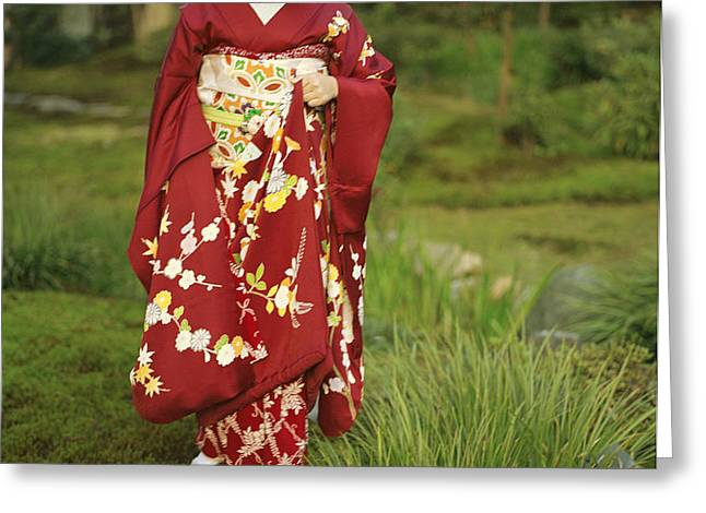 Kimono-clad Geisha In A Park Greeting Card by Justin Guariglia