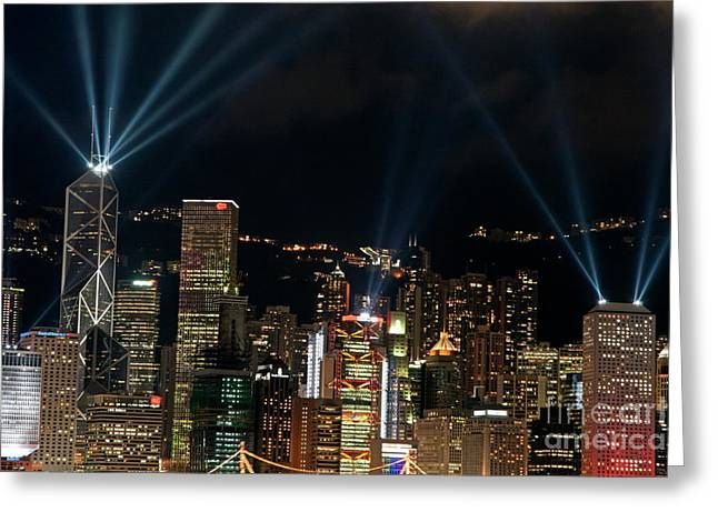 Sami Sarkis Greeting Cards - Laser show over city at night Greeting Card by Sami Sarkis