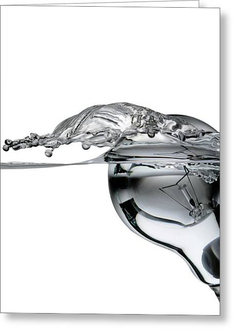 Clever Photographs Greeting Cards - Light Bulb And Splash Water Greeting Card by Setsiri Silapasuwanchai