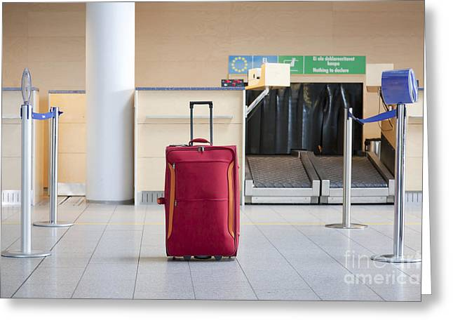 Rolling Luggage Greeting Cards - Luggage at an Airline Check-In Counter Greeting Card by Jaak Nilson