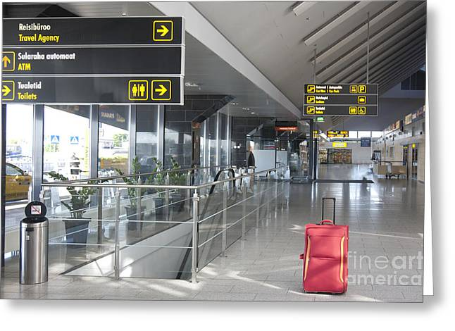 Airport Terminal Greeting Cards - Luggage Sitting Alone in an Airport Terminal Greeting Card by Jaak Nilson