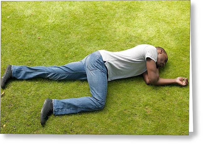 Man Looking Down Greeting Cards - Man In Recovery Position Greeting Card by