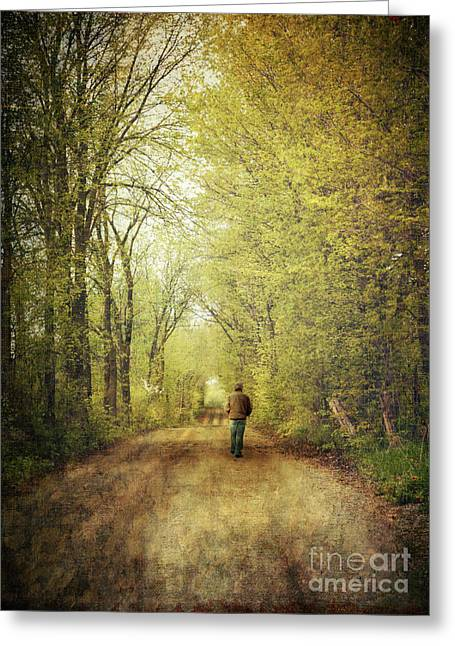 Solitaire Greeting Cards - Man walking  on a lonely country road Greeting Card by Sandra Cunningham