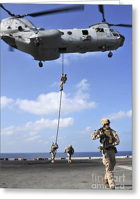 Fast Rope Greeting Cards - Marines Fast Rope From A Ch-46e Sea Greeting Card by Stocktrek Images