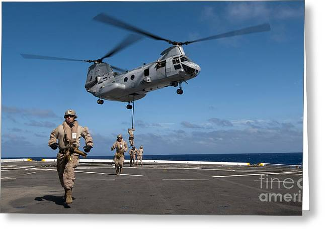 Fast-roping Greeting Cards - Marines Fast Rope On To The Flight Deck Greeting Card by Stocktrek Images