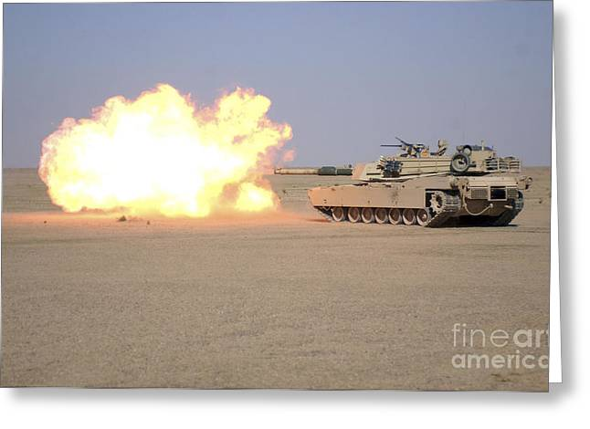 Iraq Conflict Greeting Cards - Marines Fire Their M1a1 Abrams Tank Greeting Card by Stocktrek Images