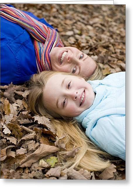Child Care Greeting Cards - Mother And Daughter On Autumn Leaves Greeting Card by Ian Boddy