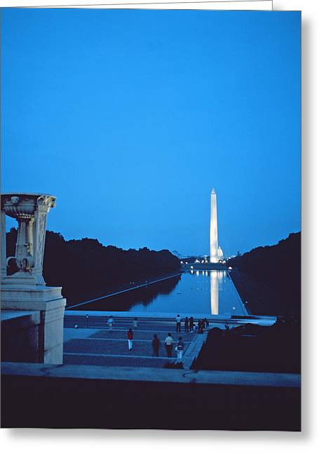 Reflecting Water Greeting Cards - Night view of the Washington Monument across the National Mall Greeting Card by American School