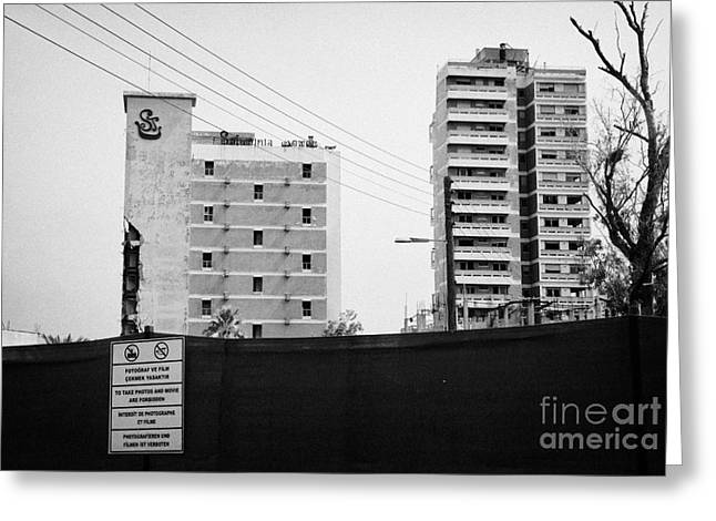 Ammochostos Greeting Cards - No Photography Warning Signs At Varosha Forbidden Zone With Salaminia Tower Hotel Abandoned In 1974 Greeting Card by Joe Fox