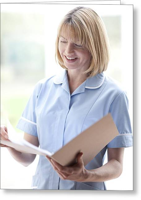District Nurse Greeting Cards - Nurse Checking Notes Greeting Card by
