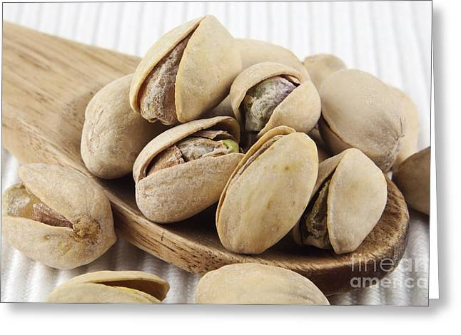 Shell Texture Greeting Cards - Pistachios on spoon Greeting Card by Blink Images