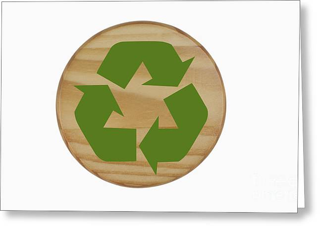 On Paper Photographs Greeting Cards - Recycling Symbol on Wood Greeting Card by Blink Images