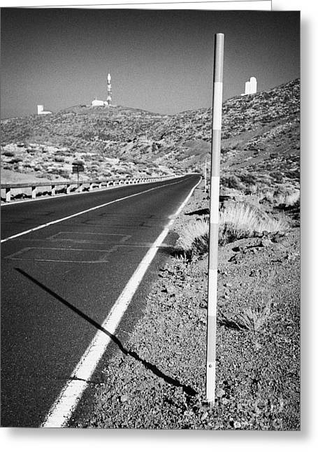 Mountain Road Greeting Cards - red and white road snow level marker on the side of the road in Teide National Park Tenerife Greeting Card by Joe Fox