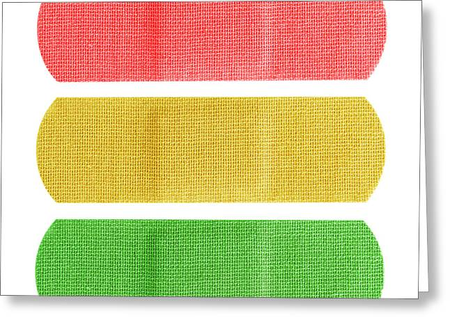 Adhesive Greeting Cards - Red yellow and green bandaids Greeting Card by Blink Images