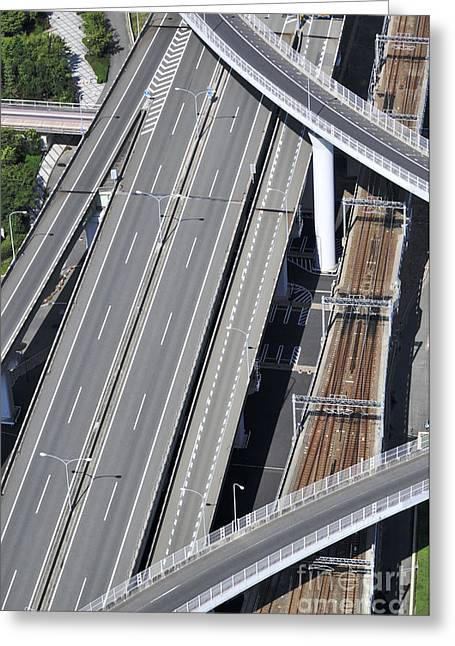 Kansai Photographs Greeting Cards - Road and rail intersection Greeting Card by Andy Smy