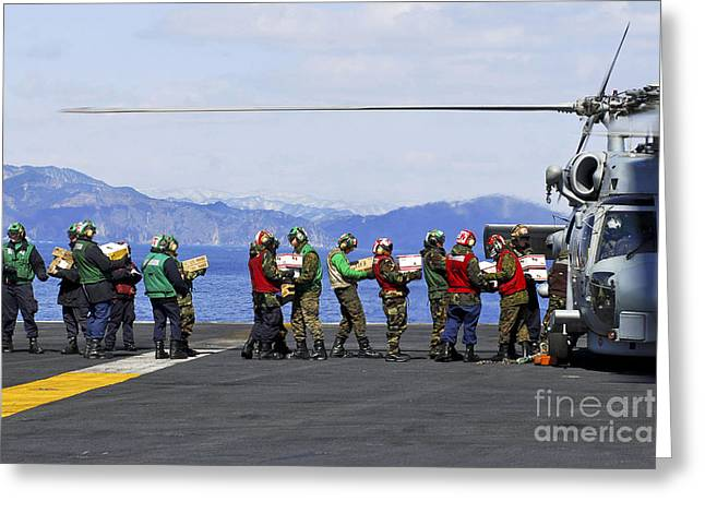 Humanitarian Greeting Cards - Sailors And Marines Load Supplies Onto Greeting Card by Stocktrek Images