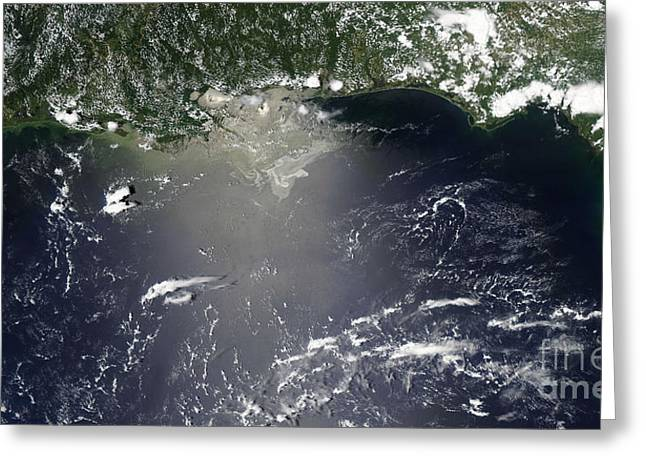 Oil Slick Greeting Cards - Satellite View Of Oil Leaking Greeting Card by Stocktrek Images