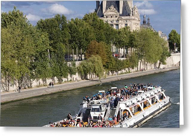 Sightseeing boat on river Seine to Louvre museum. Paris Greeting Card by BERNARD JAUBERT