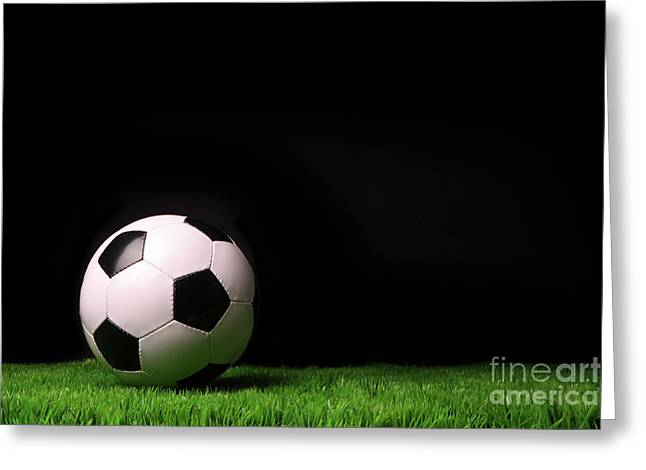 Light Grey Greeting Cards - Soccer ball on grass against black Greeting Card by Sandra Cunningham