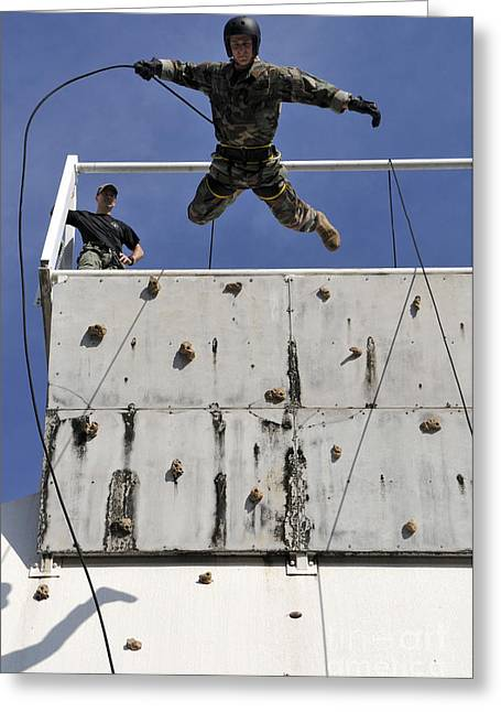 Rappel Greeting Cards - Soldier Rappels Off A Tower While Greeting Card by Stocktrek Images