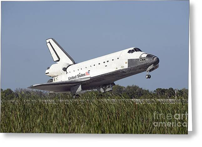 Atlantis Greeting Cards - Space Shuttle Atlantis Touches Greeting Card by Stocktrek Images