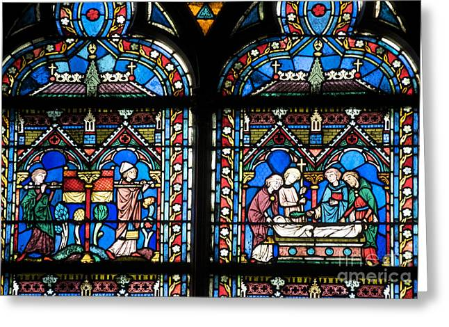 Stained Glass Windows Greeting Cards - Stained glass window of Notre Dame de Paris. France Greeting Card by Bernard Jaubert