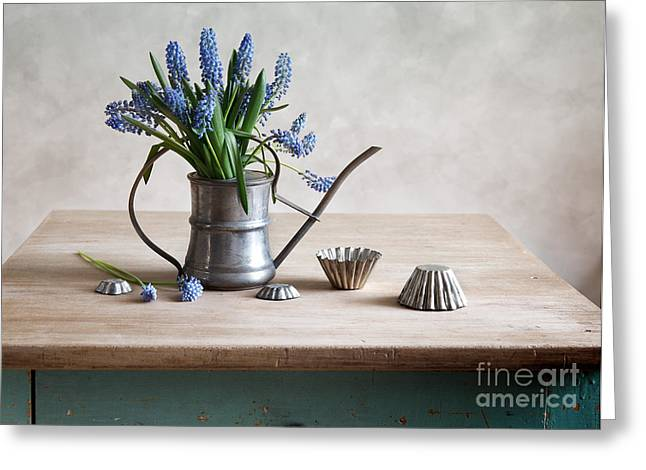 Wooden Table Greeting Cards - Still life with grape hyacinths Greeting Card by Nailia Schwarz