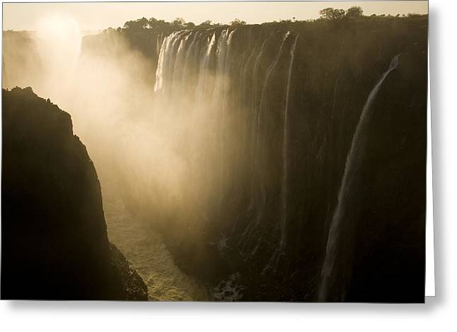Zambia Waterfall Greeting Cards - Sunlight Illuminates Mist Rising Greeting Card by Ralph Lee Hopkins