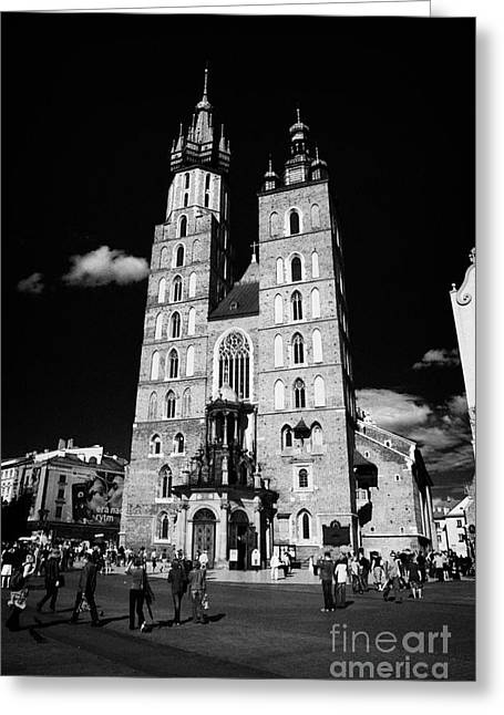 Polish City Greeting Cards - The 14th century gothic basilica of the Virgin Mary with tourists in rynek glowny town square krakow Greeting Card by Joe Fox