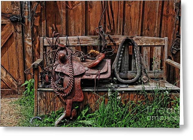 Wood Bench Greeting Cards - The Western Saddle Greeting Card by Paul Ward