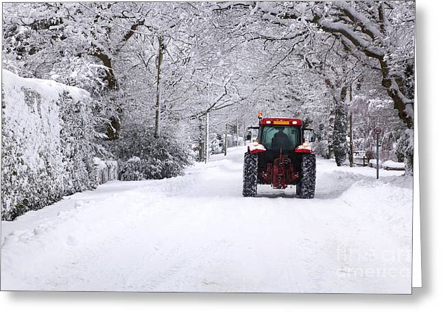 Kerb Greeting Cards - Tractor driving down a snow covered road Greeting Card by Richard Thomas