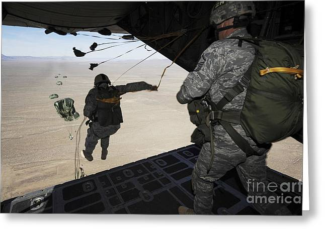 Courage Greeting Cards - U.s. Airmen Jump From A C-130 Hercules Greeting Card by Stocktrek Images