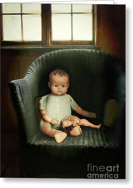 Porcelein Greeting Cards - Vintage dolls on chair in dark room Greeting Card by Sandra Cunningham