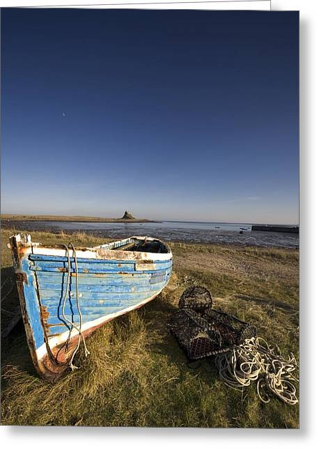 Holy Vessels Greeting Cards - Weathered Fishing Boat On Shore, Holy Greeting Card by John Short