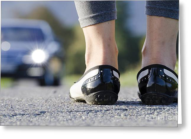 Leg Lamp Greeting Cards - Woman standing on a road Greeting Card by Mats Silvan