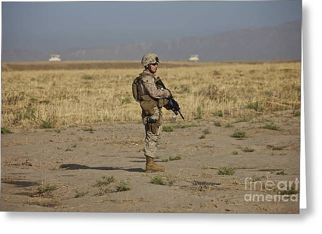 Full-length Portrait Greeting Cards - U.s. Marine Patrols A Wadi Near Kunduz Greeting Card by Terry Moore