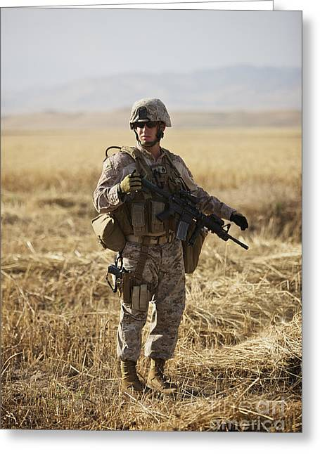 U.s. Marine Patrols A Wadi Near Kunduz Greeting Card by Terry Moore