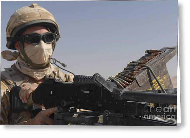 Fed Greeting Cards - A British Army Soldier Mans A Machine Greeting Card by Andrew Chittock