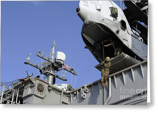Overhang Greeting Cards - A Soldier Fast-ropes From The Rear Greeting Card by Stocktrek Images