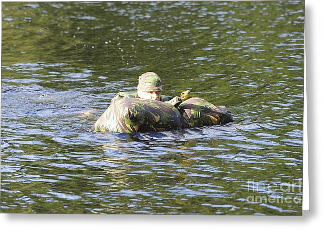 Shoulder Bag Greeting Cards - A Soldier Participates In A River Greeting Card by Andrew Chittock