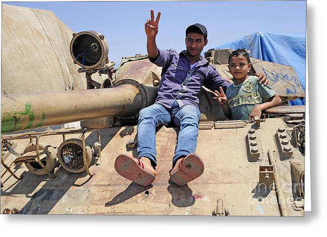 Russian Civil War Greeting Cards - A T-55 Tank With Two Children Playing Greeting Card by Andrew Chittock