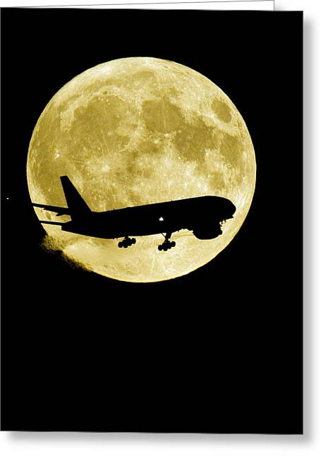 Aeroplane Silhouetted Against A Full Moon Greeting Card by David Nunuk