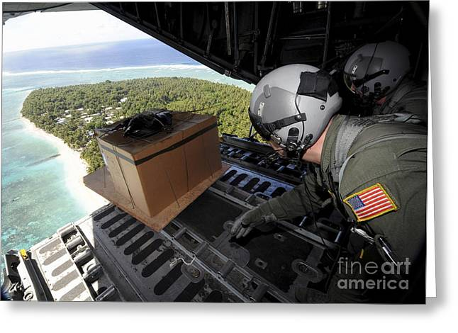 C-130 Hercules Greeting Cards - Airmen Push Out A Pallet Of Donated Greeting Card by Stocktrek Images