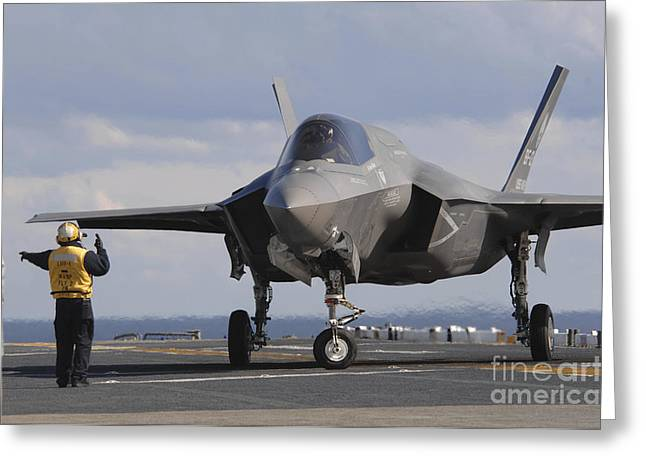 Landing Gear Greeting Cards - An Aviation Boatswains Mate Directs An Greeting Card by Stocktrek Images