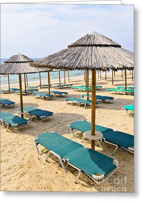 Vacant Greeting Cards - Beach umbrellas on sandy seashore Greeting Card by Elena Elisseeva