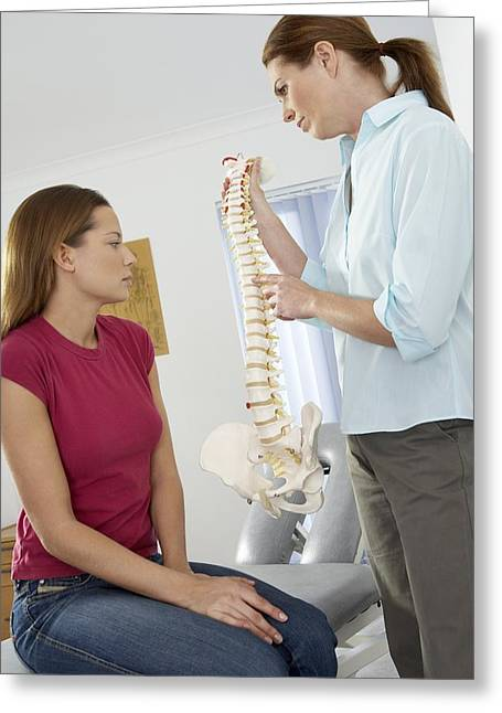 Chiropractor And Patient Greeting Card by Adam Gault