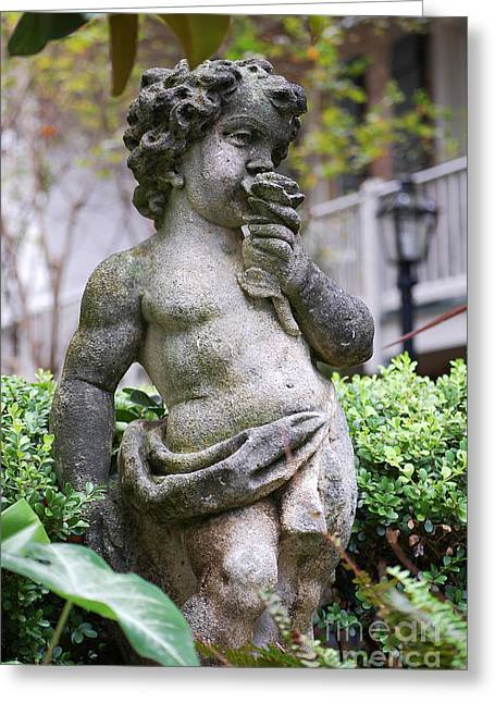 Garden Statuary Greeting Cards - Courtyard Statue of a Cherub Smelling a Rose French Quarter New Orleans  Greeting Card by Shawn O