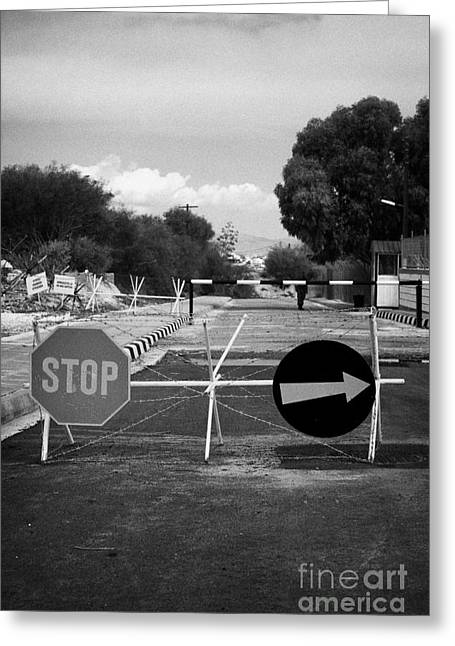 Roadblock Greeting Cards - greek cypriot army memorial sign at the UN buffer zone in the green line dividing cyprus Greeting Card by Joe Fox