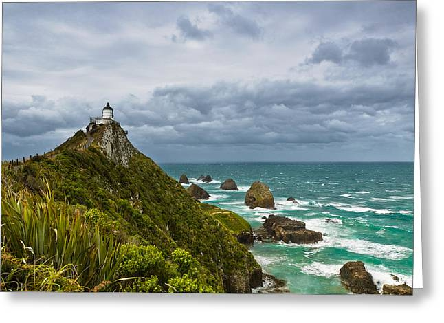 Boundless Greeting Cards - Nugget Point Light House and dark clouds in the sky Greeting Card by Ulrich Schade