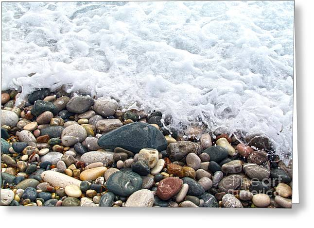 Sea Shore Greeting Cards - Ocean Stones Greeting Card by Stylianos Kleanthous